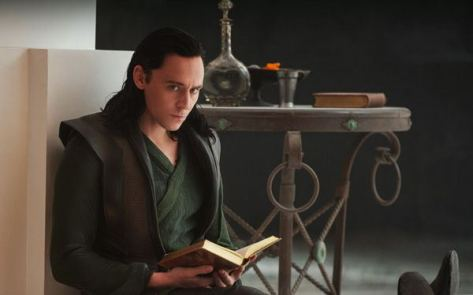 "Loki reading ""How to Rule Asgard and Influence Cosmic Events of Import, 2nd ed."""